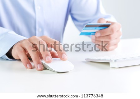 Online payment, close up of human hands shopping on line - stock photo