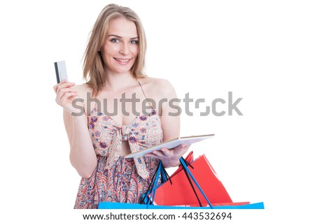 Online payment concept with shopping woman holding tablet and credit card isolated on white background with copyspace