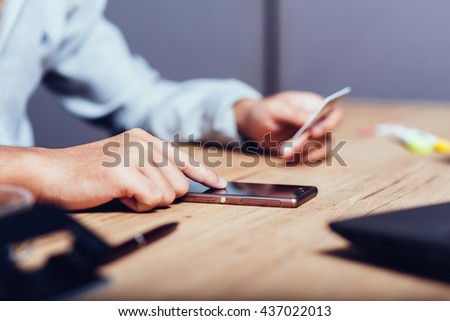 Online payment,hand using phone on worktable