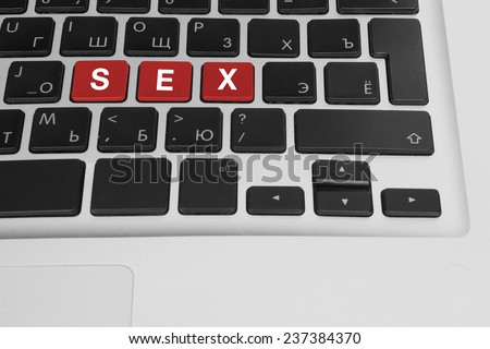 Online porn concept. sex buttons on the computer keyboard