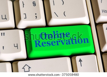 Online Reservation   on computer keyboard -  online booking concept - stock photo