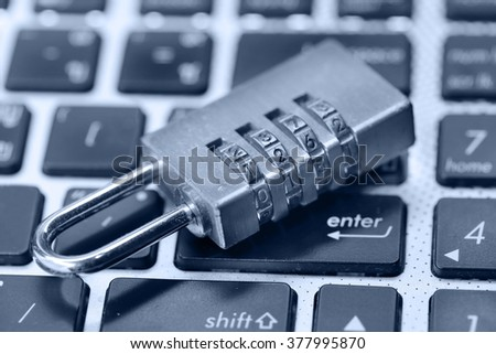online security concept a lock on computer keyboard