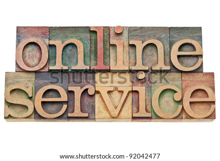 online service - internet concept - isolated text in vintage wood letterpress printing blocks, stained by color inks