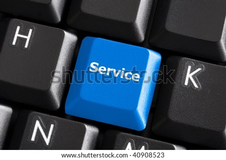 online service or contact us concept with button on computer keyboard - stock photo