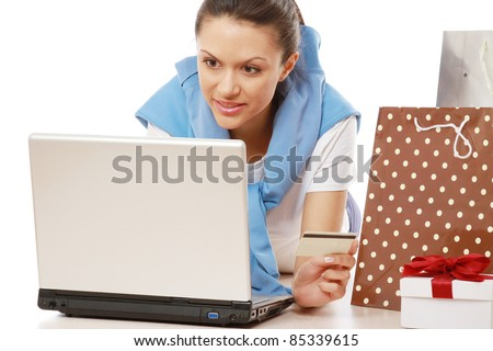 Online shopper lying on floor with laptop isolated
