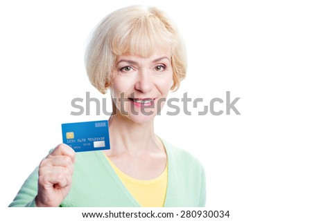 Online shopping. Attractive middle aged woman showing bank card. Isolated on white. - stock photo
