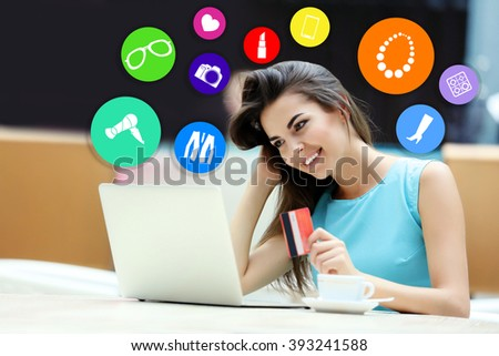 Online shopping. Beautiful young woman with laptop and credit card - stock photo
