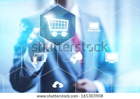 Online shopping business concept selecting shopping cart - stock photo