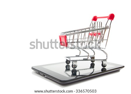 Online shopping concept - Empty Shopping Cart and tablet pc or smartphone isolated on white background. Copy space for text.