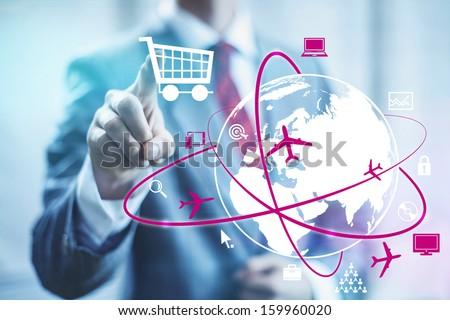 Online shopping concept man selecting shopping cart - stock photo