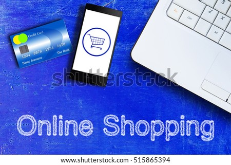 Online shopping concept, mobile phone, credit card and laptop on blue vintage background