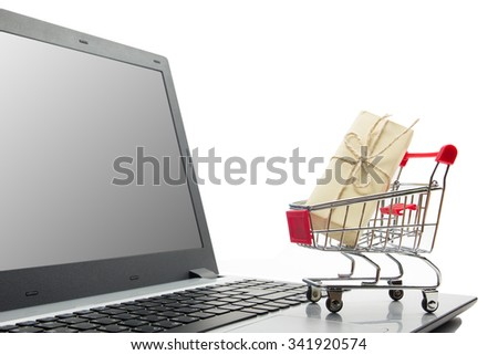 Online shopping concept - Shopping Cart, laptop, gift box isolated on white background. Copy space for text. Black friday