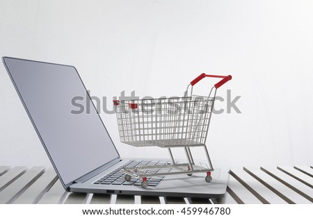 online shopping concept with 3d rendering shopping cart on notebook