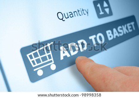 Online Shopping - Finger Pushing Add To Basket Button On Touchscreen