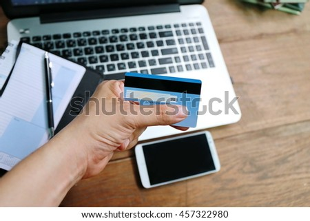 Online shopping,hands holding credit card and using laptop,personal loans, working  in coffee shop, businessman hand busy using laptop at office desk,shopping online lifestyle, personal loans