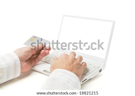 Online shopping. Hands with credit card and laptop isolated on white. - stock photo