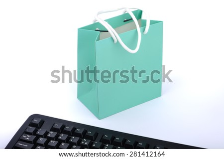 Online Shopping or Internet Shop Concepts, with Shopping Paper Bag and Keyboard - stock photo