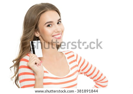Online shopping. Portrait of a young beautiful brunette girl posing smiling and holding a credit banking card in her hand, isolated on white background - stock photo