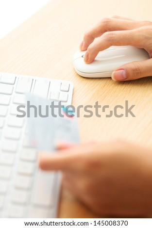 Online shopping with credit card and keyboard - stock photo