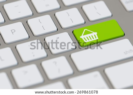 Online shopping with e-commerce symbol on a keyboard (3D Rendering) - stock photo