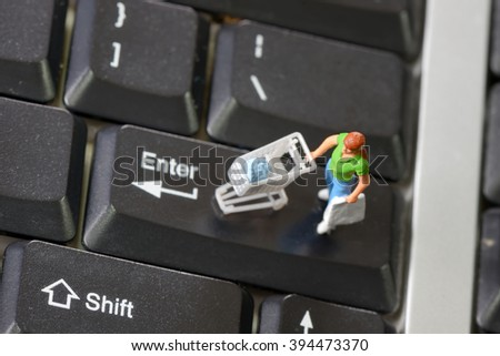 Online shopping with shopper on a computer keyboard - stock photo