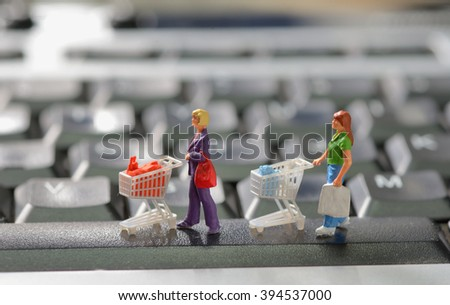 Online shopping with shoppers on a computer keyboard - stock photo