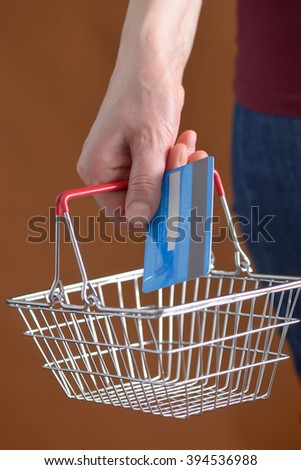 Online shopping with shopping basket and credit card - stock photo