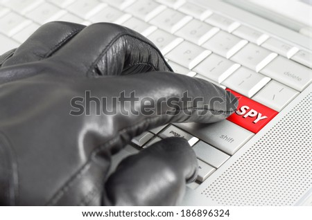 Online spying concept with hand wearing black glove  - stock photo