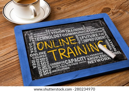 online training concept with related word cloud handwritten on blackboard - stock photo