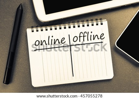 Online versus Offline on notepad with mobile and tablet