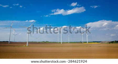Onshore windmill power plant in northern Germany - stock photo