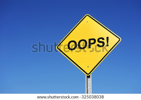 oops sign against blue sky - stock photo