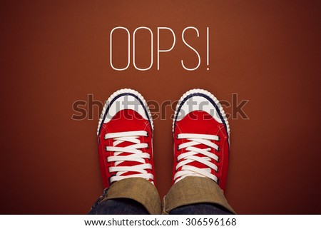 Oops, Young Person Made a Mistake Concept with Red Sneakers from above, Top View - stock photo