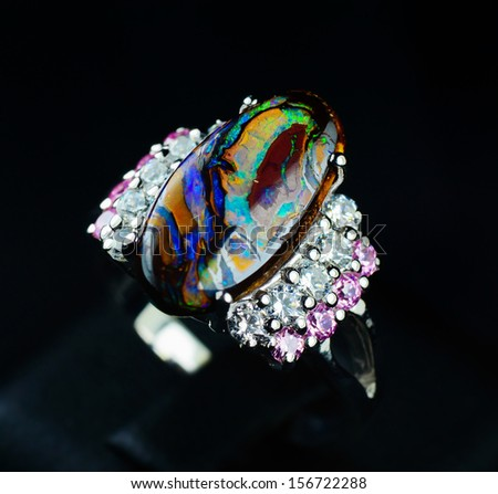 Opal and diamond silver ring - stock photo