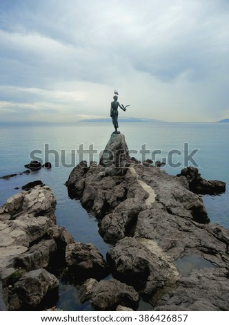 Opatija, Croatia â?? August 2014: The Girl with the Seagull sculpture made by the sculptor Zvonko Car, the symbol of the town Opatija located on a rock
