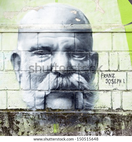 OPATIJA CROATIA - CIRCA JULY 2013: Franz Joseph I. graffiti in Angiolina park, Opatija circa July 2013. Faces on this wall represent famous people who visited this Croatian touristic city. - stock photo