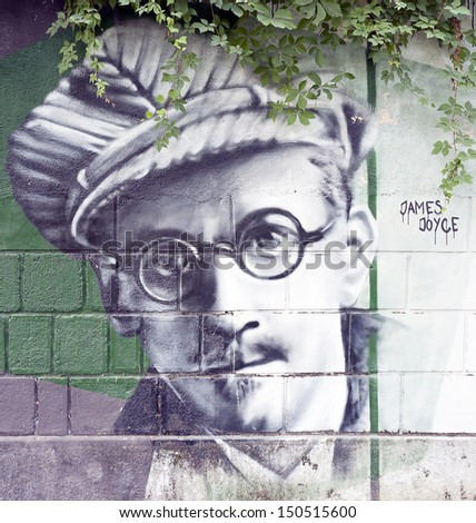 OPATIJA CROATIA - CIRCA JULY 2013: James Joyce graffiti in Angiolina park, Opatija circa July 2013. Faces on this wall represent famous people who visited this Croatian touristic city. - stock photo