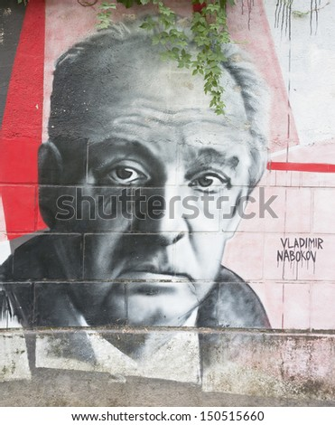 OPATIJA CROATIA - CIRCA JULY 2013: Vladimir Nabokov graffiti in Angiolina park, Opatija circa July 2013. Faces on this wall represent famous people who visited this Croatian touristic city. - stock photo
