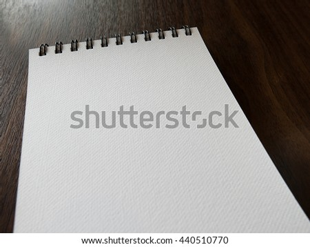 Open a blank white notebook on table, Selective focus - stock photo