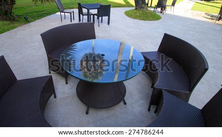 Open-air cafe furniture, wicker chairs and table - stock photo