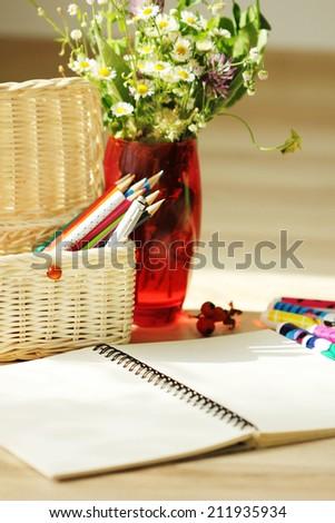 open album notebook pencils bouquet - stock photo