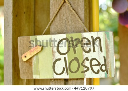 Open and close icons on a wooden background