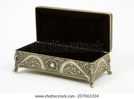 open and empty gold casket on a white background - stock photo