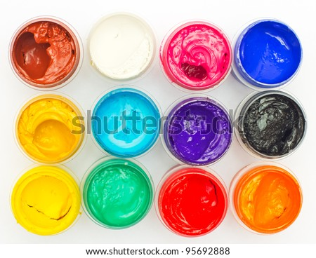 Open banks of a paint with different colours - stock photo