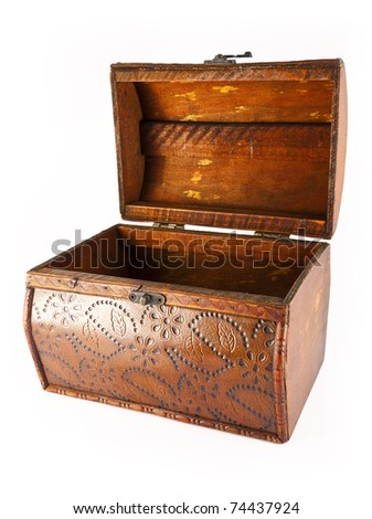Open, beautiful, wooden chest decorated with ornaments on a white background.
