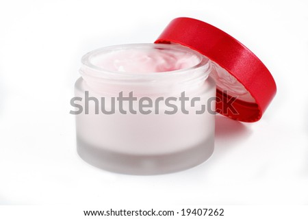 Open beauty cream jar on white background