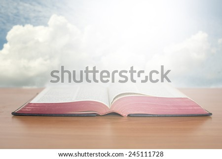 open bible with sky - stock photo