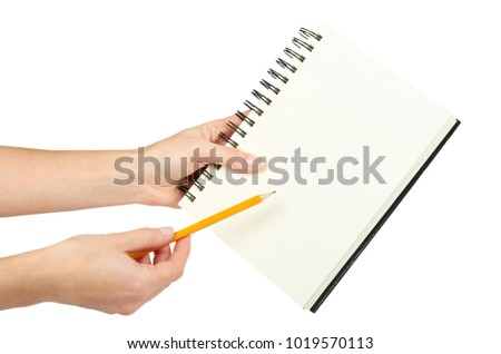 Open black notebook for writing or drawing on spiral in hand, isolated on white background.