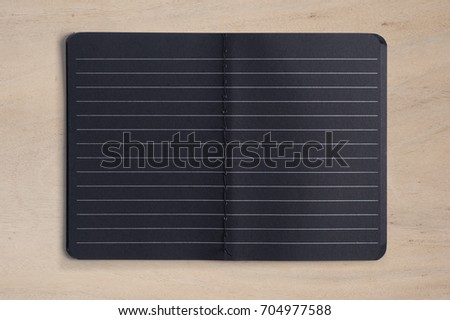Open Blank Black Notebook  on Wood Table With Copy Space.Back to school concept.