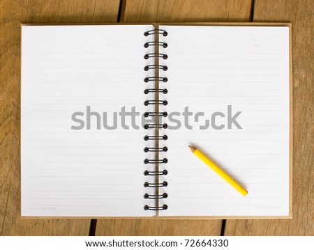 Open blank note book on  wood